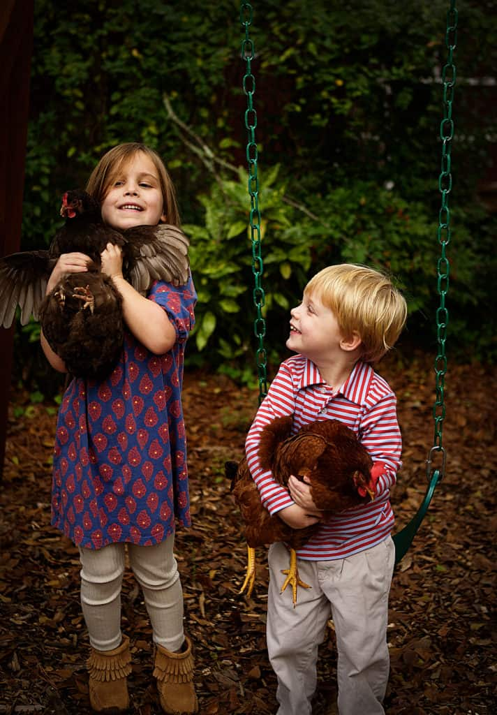 Adorable kids with hens